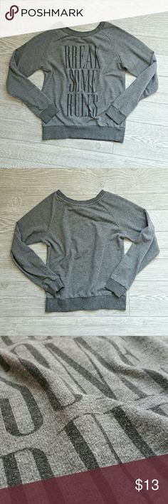 "Break Some Rules Sweater Grey ""Break Some Rules"" crew neck sweater. In good used condition. Medium weight cotton poly material.   Bundle to save even more!! Tops Sweatshirts & Hoodies"