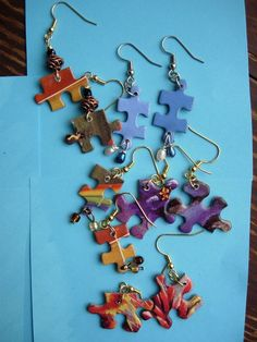 Items similar to Autism awareness month: Puzzle dangle earrings using recycled puzzle pieces on Etsy