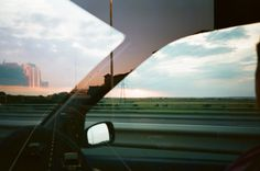 """gingermob:    """"Last week I shot a roll of film that I'd got free with a second hand camera. When I got back the scans I found out that the roll had already been used by the guy who gave me it and so I had double exposed it. By chance, both of us had taken a photo of a motorway landscape and this was made. His photo is from the inside of the car looking at countryside and my shot of an urban motorway is best seen on the left hand side."""""""
