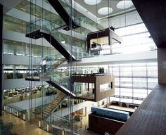 Mortgage Bank Interior Design Photo A staircase leads up to the atrium where suspended meeting rooms, glass elevators, staircases, balconies and walkways create a lively working environment; three cantilevered glazed meeting rooms are suspended from the third and fifth floors.