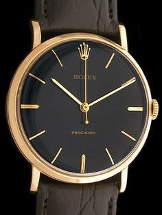 Black and Gold Vintage Rolex