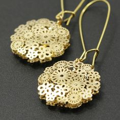 Gold floral earrings: long, from Shoogi on etsy