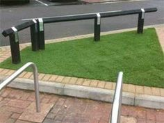 Artificial Grass for car parks, giving a bit of low maintenance green to a very urban space!