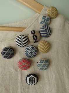buttons covered with beautiful upholstery fabrics used as embellishments