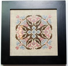 A mandala pattern in pink, blue and brown. This lovely geometric piece will add intrigue to any room in your house. Let it start the conversations and break the ice if needed. Hand stitched by Mel. Silk fibers (thread) used on linen.