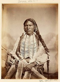 Portrait of Young Kiowa Man with Fur-Wrapped Braid, Hairpipe Breast- Plate, Ornaments, and Fur Quiver Native American Pictures, Native American Beauty, American Indian Art, Native American Tribes, Native American History, American Indians, Rocky Mountains, Native Indian, Native Art