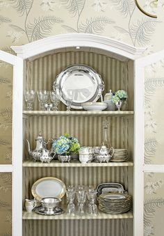 There's no reason to keep your silver heirlooms hidden. Southerners love to show off their silver as a decorative display.