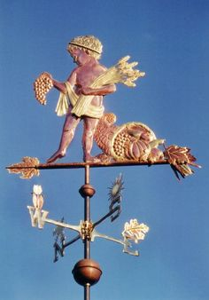 Cupid Weather Vane Autumn Cupid  by West Coast Weather Vanes.  This beautifully detailed Cupid weathervane reflects the different  seasons with a unique design  depicted on each of the directionals.