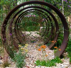 Imagine bogainvillia wrapped around these or fragrant jasmine or wisteria, making a flower tunnel.omw make bows with bent bamboo/reeds