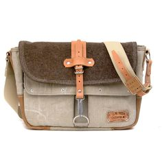 """Made from a recycled italian duffle bag,  a swiss-army blanket and an used leather-jacket.  Inside there are two useful open pockets.  Outside there are 3 pockets one with a zip,  the others have got a velcro. Keyfinder inside.  * Outside: Italian duffle bag, swiss-army blanket, used leather jacket  * Lining: Oxford Nylon ( wateresistant Hi-Tech fabric ) * Pockets: 3 pockets outside in front, 2 inside * Strap: adjustable 39""""- 47"""" ( 100-120cm ) * Large enough to hold a 12"""" laptop c..."""