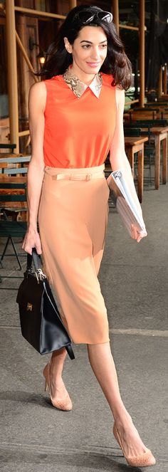 Amal Clooney in a tank with python print collar, perfectly tailored pencil skirt, and nude heels