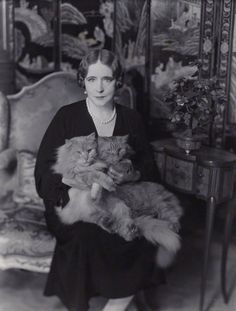 Elinor Glyn with her cats Candide and Zadig