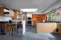 Canterbury House by CCI Renovations  I like the idea of a bright off setting wall