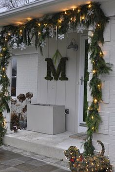 Front door garland with icicles and snowflakes rather than round ornaments. This would be a great decoration all winter long