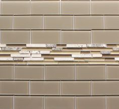 Our Manhattan 3x6 glass subway tiles combined with Bliss Cappucino Strip Mosaic Tiles.   $14.99 - $15.99/Sq Ft RockyPointTile.com