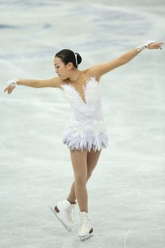 One of my all time favourite dresses.   Mao Asada's very feathery Swan Lake