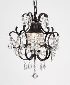 Wrought iron and crystals. Love this look but this chandelier is way too small.