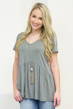 """Nothing's more girly and sweet than this simple babydoll top. This top features a v-neck, short sleeves, and a flared out bottom. Add a long necklace for an even more girly feel! Model is 5'5"""" , and s"""