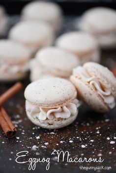 Eggnog Macarons are a light, airy Christmas cookie with the delicious taste of nutmeg and cinnamon. Plus, they are filled with eggnog buttercream frosting!