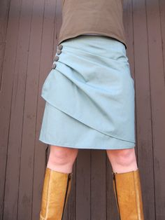 I like the draping and buttons on this wrap skirt. Gives the wrap a new twist.