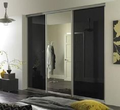 Modern bespoke fitted wardrobes to bedrooms & kitchens, we provide cheap custom fitted furniture in London UK at our designer furniture Showroom. Furniture Showroom, Furniture Design, Sliding Wardrobe Designs, Glass Panel Door, Panel Doors, Mirrored Wardrobe, Fitted Wardrobes, Black Doors, Mirror Door