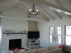 Painted Paneling - image after painting dark wood paneling with Benjamin Moore off-white White Chocolate. Interior Wood Paneling, Cedar Paneling, Painting Wood Paneling, Painting Trim, Paneling Ideas, Paneling Painted, Wainscoting Ideas, Painted Ceiling Beams, Wooden Ceilings
