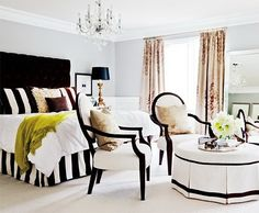 black + white bedroom with a pop of lime