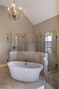 Regency Homebuilders : Master Bath, Drop-In Tub, Walk-Through Shower, Dual Shower, Shower Pebbles, Marbled Tile, Granite, Chandelier, Recessed Lighting, Rustic Style, Black Doors (Windsor Park Bartlett- Riviera Plan)