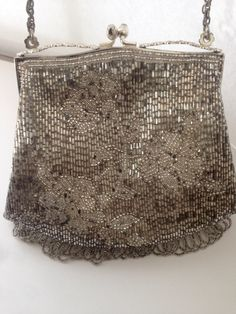 A personal favorite from my Etsy shop https://www.etsy.com/listing/230057322/vintage-silver-clutch-purse-handmade