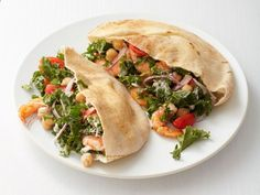 Fill these Shrimp and Kale Pitas with a mixture of shrimp, kale and chickpeas for a simple hand-held dinner.