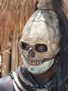 Skeletal celebrator on the beach of Playa del Carmen