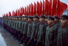 Barbey managed to capture the human moments in all of his subjects, even this member of the Guard of Honor of the People's Liberation Army caught peeking at the camera. | 16 Rarely Seen Photos Capture Four Decades Of Chinese History