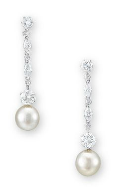 A PAIR OF NATURAL PEARL AND DIAMOND EAR PENDANTS EACH SET WITH A BUTTON-SHAPED WHITE NATURAL PEARL MEASURING APPROXIMATELY 7.5 - 8.3 MM, SUSPENDED FROM A FLEXIBLE BRILLIANT AND MARQUISE-CUT DIAMOND LINK, MOUNTED IN PLATINUM, 4.1 CM LONG