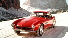 red bmw 507 ::: The BMW 507 is a roadster produced by BMW from 1956 to 1959.  Initially intended to be exported to the United States at a rate of thousands per year, it ended up being too expensive, resulting in a total production figure of 252 cars...