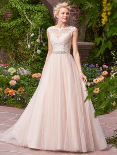 Rebecca Ingram - CARRIE, Charming and romantic, this tulle ballgown features lace appliqués that cascade over the bodice, illusion bateau neckline, and illusion back. Finished with covered buttons and zipper closure. Detachable beaded belt on grosgrain ribbon sold separately.