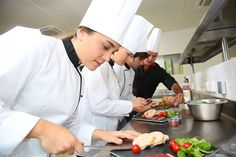 chef: Team of young chefs preparing delicatessen dishes Roasted Baby Carrots, Roasted Cauliflower, Gourmet Festival, Catering, Baby Carrot Recipes, Becoming A Chef, Raisin Recipes, Kitchen Helper, Gastronomia