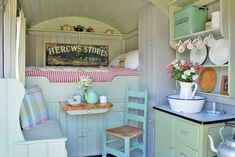 Vintage trailer (love the enamel topped cabinet and the bread bin) would be a great school bus re-do