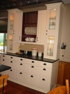 Creamy white with darker grey-black counters. Nice brown insert and nice glass…