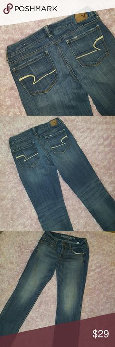 """Skinny American Eagle Jeans Size 4 Regular 99% cotton 1% ELASTINE American Eagle Skinny Size 4 Regular length. Wore only twice. Like new No flaws, stains etc. Legs have a distressed lightening down front and back and also the """"whiskered"""" effect. American Eagle Outfitters Jeans Skinny"""