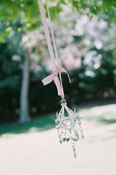 Hanging mini chandeliers on a string or silk ribbon is an easy way to add style and glamor to any outdoor space.