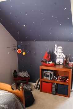 Boys rooms painted wall with glow in the dark paint as stars