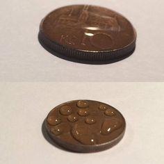 povrchové napětí - vodní kapky na minci