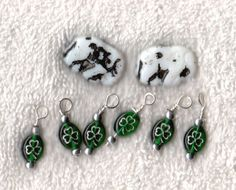 Czech Seed Beads Elephant Czech Glass - White / Black 6 4 leaf clover charms by EunicesTickleTrunk on Etsy