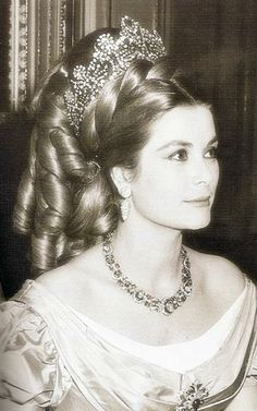 Princess Grace - wearing an astonishing hairpiece and Josephine's coronation tiara, which was loaned to her by Van Cleef and Arpels for a ball