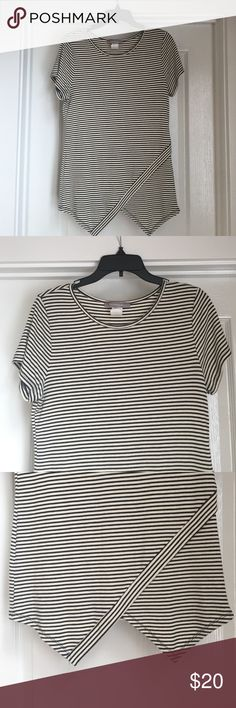 Striped Top Beautiful top that looks so cute with boots and jeans or leggings. I lost some weight and it's just too big on me. Excellent condition, only worn 2 or 3 times. Would fit an adult medium size, I'm usually a small size. Tops