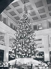 Breakfast under the tree at Marshall Fields - For many Chicago children and their parents, no Christmas is complete without a downtown visit to Marshall Field's to gaze at the holiday tale unfolding in the State Street store's windows and enjoy a festive meal upstairs in the Walnut Room. The tradition of a lavishly decorated tree in the Walnut Room dates back to 1907-though fire safety has dictated an artificial conifer since the 1960s. In 1944 and 1945, the Field's windows first related…