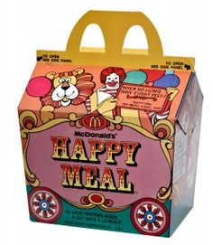 """In 1979 McDonald's rolled out the U.S.'s first Happy Meal. It was circus-wagon-themed and came with the standard hamburger or cheeseburger option, as well as French fries, cookies, a soft drink and — of course — a toy. Upon opening their meal, kids got either a """"McDoodler"""" stencil, a """"McWrist"""" wallet, an ID bracelet, a puzzle lock, a spinning top or a McDonaldland-character eraser."""