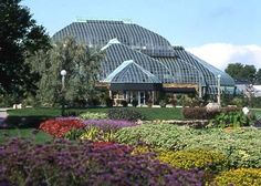 The stunning Lincoln Park Conservatory sits in the eponymous park & houses a botanical garden inside & surrounded by the Great garden outside. Be sure to visit it when visiting the Zoo!