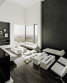 I love this black and white living room! Abu Samra House | Symbiosis Designs