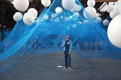 Globes of light behind tented netting; Enjoying the material - News & Stories at STYLEPARK